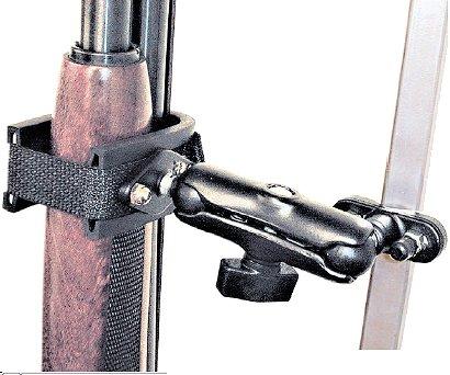 Rugged gear swing arm floor mount w ubolt for 12 gauge shotgun lying on the floor